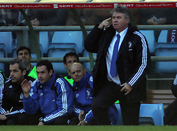 Chelsea manager Guus Hiddink makes his point as asst Ray Wilkins looks bemused during the Barclays Premier League match between Aston Villa and Chelsea at Villa Park on February 21, 2009 in Birmingham, England.