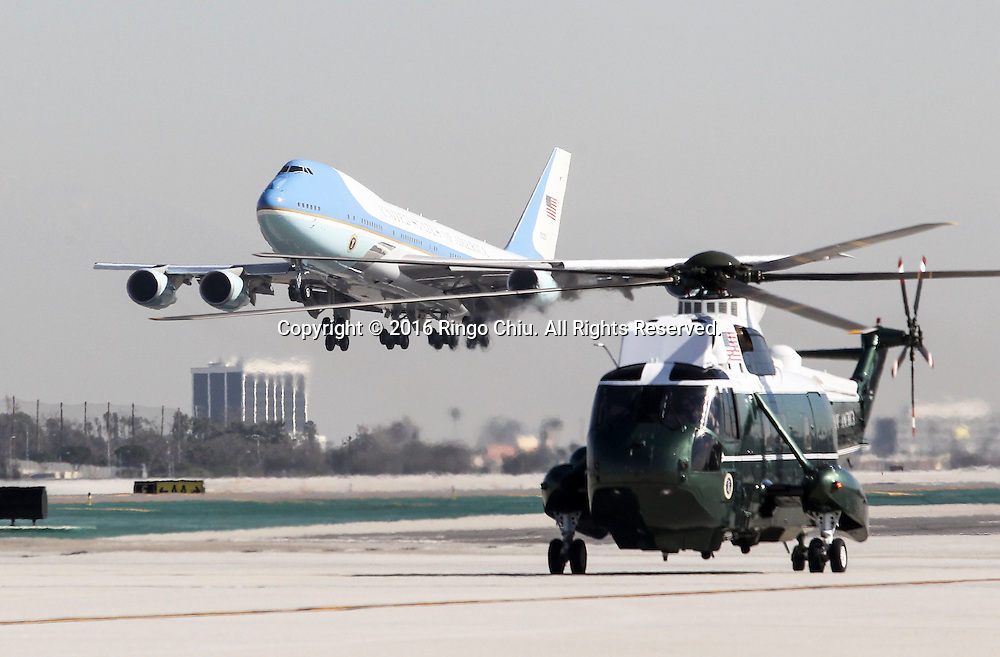 Marine One sitting on the tarmac as Air Force One with President Barack Obama departs at Los Angeles International Airport in Los Angeles, Friday, Feb 12, 2016.(Photo by Ringo Chiu/PHOTOFORMULA.com)<br /> <br /> Usage Notes: This content is intended for editorial use only. For other uses, additional clearances may be required.