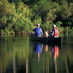Freedom, NH..Fly-fishing from a canoe in Trout Pond.  Part of future town forest.