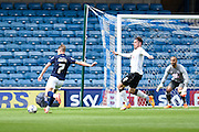 Lee Martin about to be fouled by Richard Keogh and win the penalty which led to Millwall's second goal during the Sky Bet Championship match between Millwall and Derby County at The Den, London, England on 25 April 2015. Photo by David Charbit.