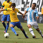 Oscar, Brazil, (left) is challenged by Javier Mascherano, Argentina, during the Brazil V Argentina International Football Friendly match at MetLife Stadium, East Rutherford, New Jersey, USA. 9th June 2012. Photo Tim Clayton