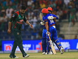 September 20, 2018 - Abu Dhabi, United Arab Emirates - Afghanistan cricketer Rashid Khan is congratulated by Najibullah Zadran  during the 6th cricket match of Asia Cup 2018 between Bangladesh and Afghanistan at the Sheikh Zayed Stadium,Abu Dhabi, United Arab Emirates on September 20, 2018. (Credit Image: © Tharaka Basnayaka/NurPhoto/ZUMA Press)