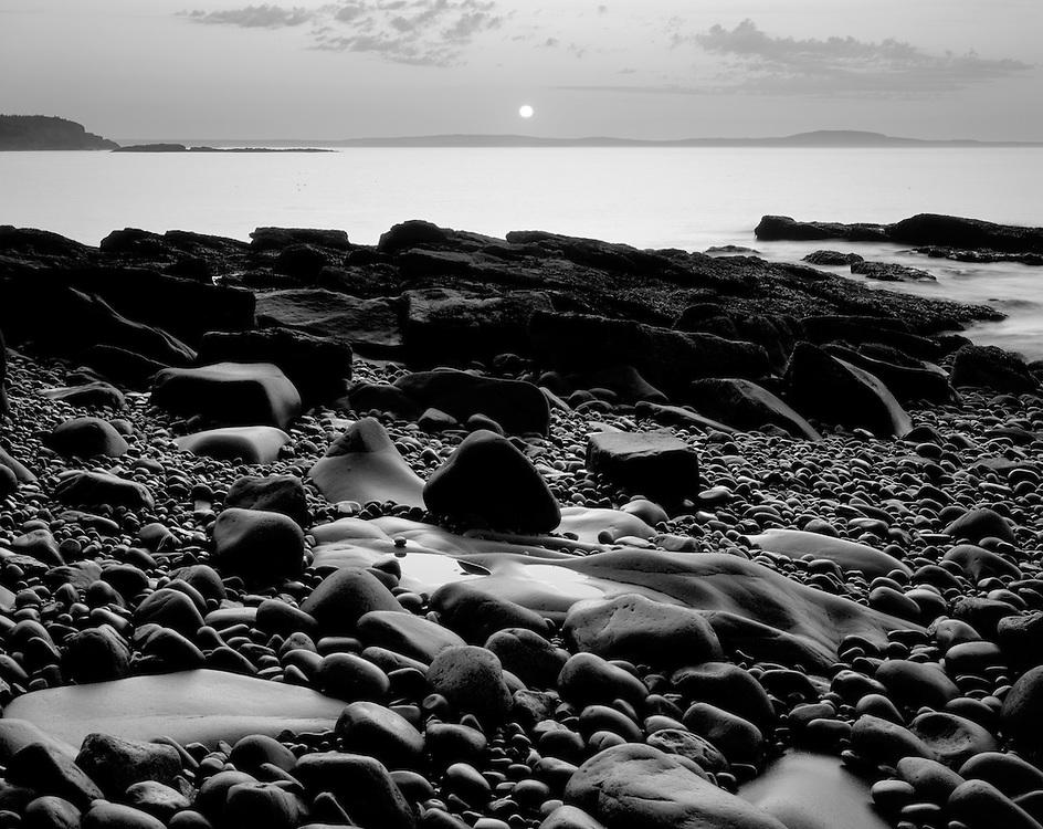 Sunrise on wave-worn rocks near Otter's Cliffs, Acadia National Park, Maine