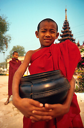 BURMA PAGAN MAR95 - A buddhist novice monk holds on to his laquered rice bowl as he goes on his obligatory daily round of begging. In buddhist tradition, novices, once initiated, retain their lifelong right to return to a monastic lifestyle whenever they wish... jre/Photo by Jiri Rezac. . © Jiri Rezac 1995. . Contact: +44 (0) 7050 110 417. Mobile: +44 (0) 7801 337 683. Office: +44 (0) 20 8968 9635. . Email: jiri@jirirezac.com. Web: www.jirirezac.com