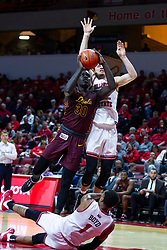 NORMAL, IL - January 19: Aher Uguak takes a shot with Matt Chastain attempting a block from behind after Dedric Boyd falls to the floor during a college basketball game between the ISU Redbirds and the Loyola University Chicago Ramblers on January 19 2020 at Redbird Arena in Normal, IL. (Photo by Alan Look)