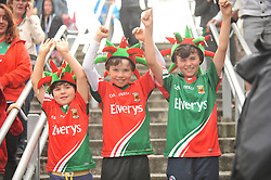 Sam, Harry and Ben Smith from Claremorris show their delight in Croke Park as Mayo got the better of Cork in the quarter final match.<br />Pic Conor McKeown