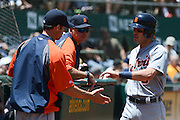 May 29, 2014; Oakland, CA, USA; Detroit Tigers second baseman Ian Kinsler (3) is congratulated for scoring against the Oakland Athletics during the third inning at O.co Coliseum.