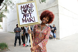 Krystal W. waits for the AntiRacism Rally to begin at the Confederate Cemetery adjacent to Dallas City Hall. Hundreds of protestors congregated to protest President Donald Trump, neo-nazis, KKK and other white supremacist groups.