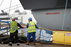 Final preparations are made by engineers and crew ahead of sea trials this summer, for the Royal Navy's new aircraft carrier HMS Queen Elizabeth, at Rosyth Dockyard in Dunfermline.