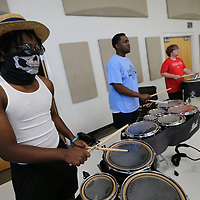 London Roberson, 16, and his section of drums practice thier routine Friday as part of their band camp at Tupelo High School.