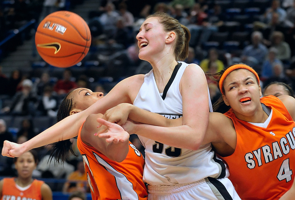 Providence's Emily Cournoyer, center, receives her third personal foul while guarded by Syracuse's Nicole Michael, left, and Vionca Murray, right, during the second half at the Big East Championships in Hartford, Conn. Saturday, March 6, 2010.  (AP Photo/Jessica Hill)