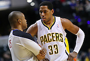 April 09, 2012; Indianapolis, IN, USA; Indiana Pacers small forward Danny Granger (33) and referee Tony Brothers (25) talk during a break in action at Bankers Life Fieldhouse. Indiana defeated Toronto 103-98. Mandatory credit: Michael Hickey-US PRESSWIRE