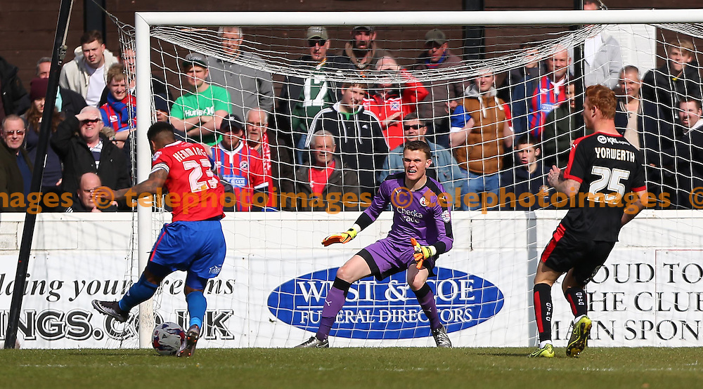 Ashley Hemmings of Dagenham slots in the third goal past Crawley&rsquo;s Keeper Callum Preston during the Sky Bet League 2 match between Dagenham and Redbridge and Crawley Town at the London Borough of Barking and Dagenham Stadium in London. April 30, 2016.<br /> James Boardman / Telephoto Images<br /> +44 7967 642437