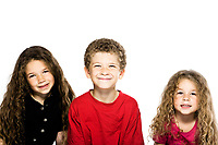 three caucasian kids smiling portrait isolated studio on white background