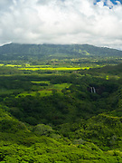 Aerial view of Wailua Falls, Kauai, Hawaii on a cloudy day.