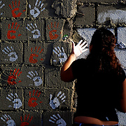 VENEZUELAN POLITICS / POLITICA EN VENEZUELA<br /> Students place their hands on the walls of the process against President Hugo Chavez / Estudiantes colocan sus manos en paredes en contra del proceso del Presidente Hugo Chavez<br /> Caracas - Venezuela 2009<br /> (Copyright © Aaron Sosa)