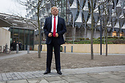 The waxwork of Donald Trump stands outside the US Embassy at Nine Elms in south London on the day when the President announced on Twitter, his refusal to visit London and open the new state premises after its historic move from Grosvenor Square, on 12th January 2018, in London, England. The waxwork is the property of Madame Tussauds and took a team of 20 artists 4 months to create, going on display on the day of his inauguration in 2017. It is valued at £150,000.