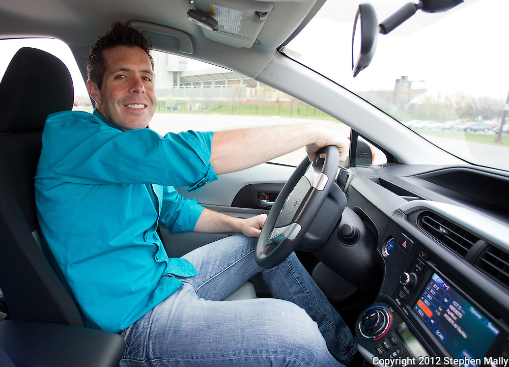 Edward Moran of Ames inside his new Toyota Prius C in Ames, Iowa on Thursday, March 29, 2012.
