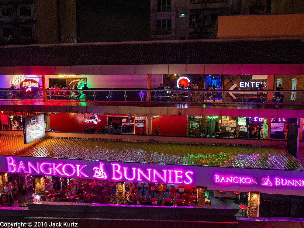 "03 NOVEMBER 2016 - BANGKOK, THAILAND:  Lights are dimmed at Nana Plaza, one of Bangkok's most famous ""adult entertainment districts."" Bangkok's infamous nightlife has been scaled back during the mourning period for the late Bhumibol Adulyadej, King of Thailand. The revered King died on 13 October 2016 at age 88. The government declared a year of mourning. The government ordered Thailand's notorious adult entertainment districts to turn off their neon lights, dress employees in black and ensure that music can't be heard on the street in front of the venues for 30 days, the government said the entertainment venues could resume normal operations on 14 November.       PHOTO BY JACK KURTZ"