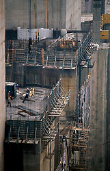 CHINA HUBEI PROVINCE THREE GORGES DAM MAY99 -- Construction materials are lowered by a crane along the wall of the Three Gorges Dam. Seven large cities, including Chongquing, and thousands of villages will be submerged once the water level rises after the completion of the controversial Three Gorges Dam project further downriver. The flooding of areas reaching back more than 550Km upriver will require the evacuation and resettlement of more than 10 million people.  jre/Photo by Jiri Rezac. . © Jiri Rezac 1999. . Contact: +44 (0) 7050 110 417. Mobile:  +44 (0) 7801 337 683. Office:  +44 (0) 20 8968 9635. . Email:   jiri@jirirezac.com. Web:     www.jirirezac.com