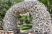 The famous Elk Antler Arch in George Washington Memorial Park, known as the Town Square in Jackson Hole, Wyoming. The Town Square's four arches are built entirely from local elk antlers. Each arch is supported by a steel framework and constructed by hand using more than 2,000 antlers each. The arches are held together mostly by friction and gravity and need to be rebuilt about every 50 years.