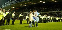Photo. Jed Wee, Digitalsport<br /> NORWAY ONLY<br /> <br /> Huddersfield Town v Lincoln City, Nationwide League Division Three Playoff Semi-finals Second Leg, 19/05/2004.<br /> Security struggled to regain control after a massive pitch invasion.
