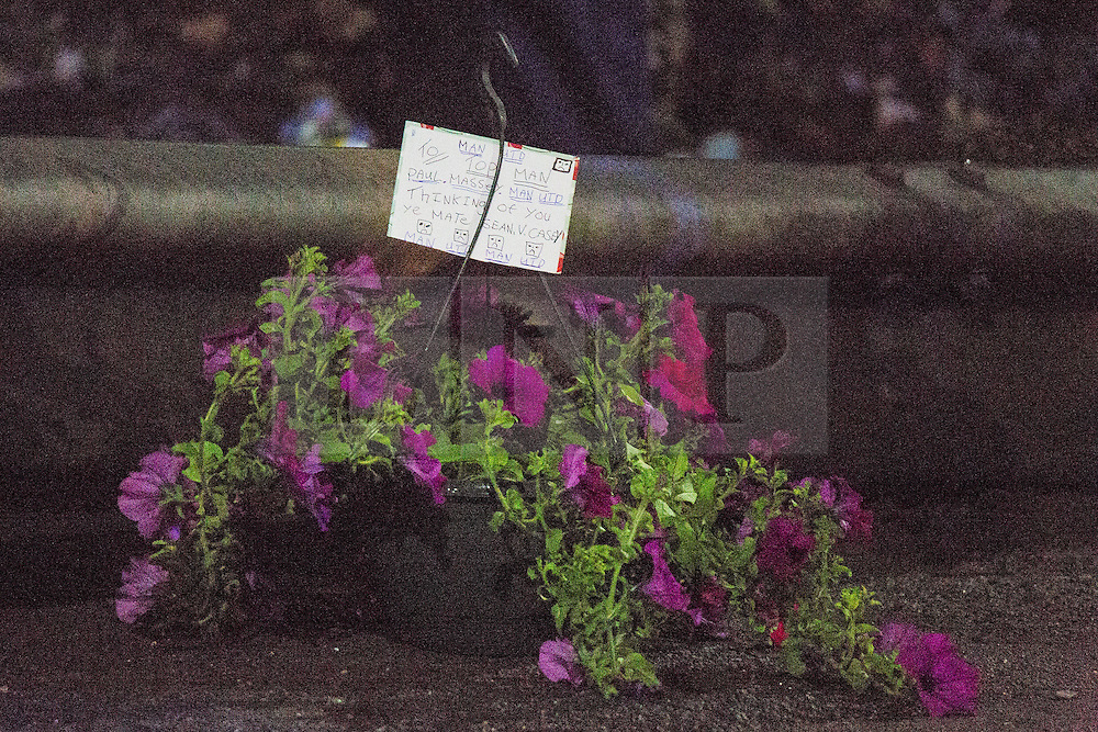 """© Licensed to London News Pictures. 26/07/2015. Salford, UK. Flowers with a tribute left at the scene on Manchester Road , Clifton , Salford where Paul Massey - known as Salford's """"Mr Big"""" has been shot dead this evening (26th July 2015 . Photo credit: Joel Goodman/LNP"""