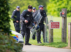 © London News Pictures. 24/05/2015. London, UK. Police officers in riot gear at Oxford University Parks in Oxford City centre, where police are currently searching for 21 year old Jed Allen who is wanted in connection with the deaths of a man, a woman and a girl, found at a property in Didcot,  Oxfordshire.. Photo credit: Ben Cawthra/LNP