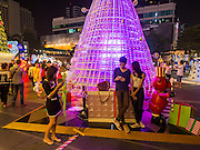 13 DECEMBER 2013 - BANGKOK, THAILAND: Thais relax in the Christmas light display at Central World shopping center in the Ratchaprasong area of Bangkok. Thailand is overwhelmingly Buddhist . Christmas is not a legal holiday in Thailand, but Christmas has become an important commercial holiday in Thailand, especially in Bangkok and communities with a large expatriate population.      PHOTO BY JACK KURTZ