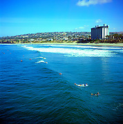 Waves and surfers at San Diego, California, USA