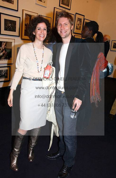 MOLLIE DENT-BROCKLEHURST and CHRISTOPHER BAILEY creative director of Burberry at a party to celebrate the opening of Photo-London 2006 at Burlington Gardens, London W1 on 17th May 2006.<br /><br />NON EXCLUSIVE - WORLD RIGHTS
