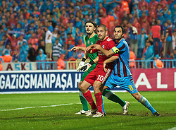 TRABZON, TURKEY - Thursday, August 26, 2010: Liverpool's Joe Cole and Trabzonspor's Selcuk Inan during the UEFA Europa League Play-Off 2nd Leg match at the Huseyin Avni Aker Stadium. (Pic by: David Rawcliffe/Propaganda)