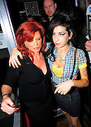 19.FEBRUARY.2008. LONDON<br /> <br /> A DRUNK AMY WINEHOUSE LEAVING JAZZ AFTER DARK BAR, SOHO AND WALKING DOWN THE ROAD BEFORE RETURNING TO THE BAR AND POSING WITH SOME WOMEN AND HUGGING SOME FANS PASSING BY. MARK RONSON THEN TURNED UP AT THE BAR BEFORE AMY LEFT AT 1.30AM WITH COCAINE UP HER NOSE AND SCABS ON HER CHEEK, SHE WAS ALSO WEARING AN ASTON VILLA FOOTBALL CLUB NECKLACE. SHE LATER RETURNED BACK TO HER HOTEL WITH MARK RONSON.<br /> <br /> BYLINE: EDBIMAGEARCHIVE.CO.UK<br /> <br /> *THIS IMAGE IS STRICTLY FOR UK NEWSPAPERS AND MAGAZINES ONLY*<br /> *FOR WORLD WIDE SALES AND WEB USE PLEASE CONTACT EDBIMAGEARCHIVE - 0208 954 5968*