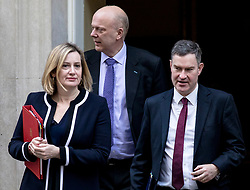 © Licensed to London News Pictures. 05/03/2019. London, UK. Secretary of State for Work and Pensions Amber Rudd (L), Transport Secretary Chris Grayling (C) and Justice Secretary David Gauke (R) leave 10 Downing Street after the Cabinet meeting. Photo credit: Rob Pinney/LNP