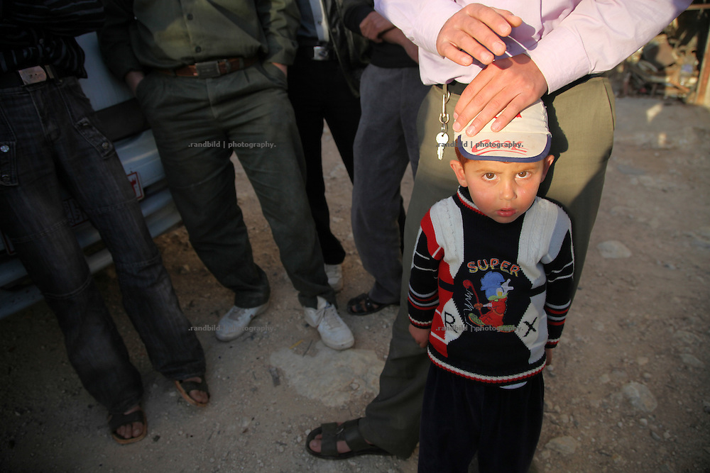 A little boy looks sceptical during sunset in Courine. Courine was been attacked by ground troops on February 22, 2012 (see archive images). aftermath air force helicopters shot  rockets several times into the 7000 inhabitants counting village south of Idlib city. Courine ist still a stronghold of opposition.