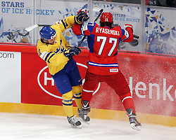 11.05.2012, Ericsson Globe, Stockholm, SWE, IIHF, Eishockey WM, Russland (RUS) vs Schweden (SWE), im Bild Sverige Sweden 10 Johan Larsson and Sverige Sweden 77 Victor Hedman collides at the boards // during the IIHF Icehockey World Championship Game between Russia (RUS) and Sweden (SWE) at the Ericsson Globe, Stockholm, Sweden on 2012/05/11. EXPA Pictures © 2012, PhotoCredit: EXPA/ PicAgency Skycam/ Morten Christensen..***** ATTENTION - OUT OF SWE *****