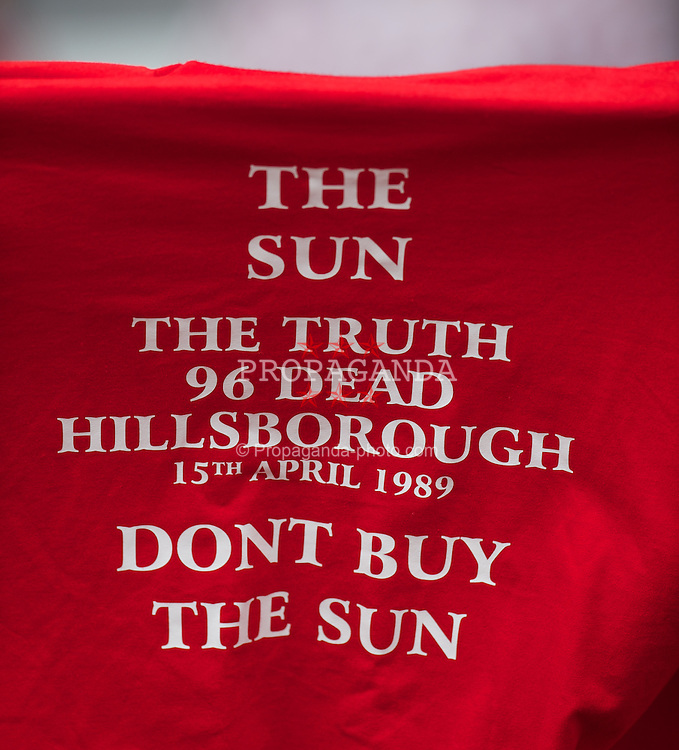 LIVERPOOL, ENGLAND - Sunday, August 12, 2012: A Liverpool supporters' t-shirt 'Don't Buy the Sun' during a preseason friendly match at Anfield. (Pic by David Rawcliffe/Propaganda)
