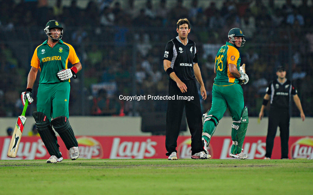Jacques Kallis, Jacob Oram and Grame Smith during the ICC Cricket World Cup quarter final match between South Africa and New Zealand held at the Shere Bangla National Stadium, Mirpur, Bangladesh on the 25 March 2011..Photo by SPORTZPICS