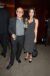 MICHAEL NYMAN and MARIA SILVERA at a dinner hosted by Liberatum to honour Francis Ford Coppola held at the Bulgari Hotel & Residences, 171 Knightsbridge, London on 17th November 2014.