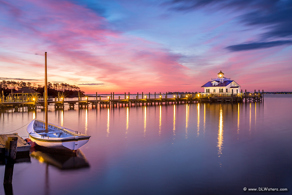Roanoke Marshes Lighthouse and Shallowbag Bay at sunrise in Manteo on the Outer Banks of NC.