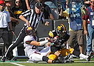 September 29 2012: Iowa Hawkeyes defensive back Tanner Miller (5) intercepts a pass intended for Minnesota Golden Gophers wide receiver A.J. Barker (82) during the first quarter of the NCAA football game between the Minnesota Golden Gophers and the Iowa Hawkeyes at Kinnick Stadium in Iowa City, Iowa on Saturday September 29, 2012. Iowa defeated Minnesota 31-13 to claim the Floyd of Rosedale Trophy.