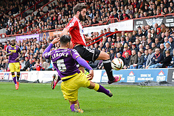 Notts County's defender Dean Leacock and Brentford's Forward Will Grigg compete for the ball   - Photo mandatory by-line: Mitchell Gunn/JMP - Tel: Mobile: 07966 386802 05/04/2014 - SPORT - FOOTBALL -  Griffin Park - London - Brentford v Notts County- Sky Bet League One