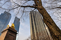 US, New York City. USS Maine Monument, Time Warner Center and Trump International Hotel and Tower. Columbus Circle, corner of Central Park, Manhattan.