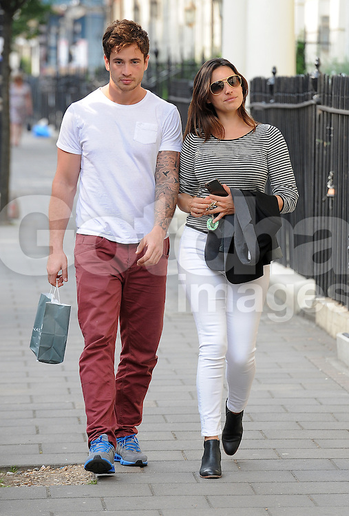 Model Kelly Brook and Rugby boyfriend Danny Cipriani arriving at Kelly's house in London, UK. 26/06/2013<br />BYLINE MUST READ : GOTCHAIMAGES.COM<br /><br />Copyright by &copy; Gotcha Images Ltd. All rights reserved.<br />Usage of this image is conditional upon the acceptance <br />of Gotcha Images Ltd, terms and conditions available at<br />www.gotchaimages.com