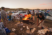 Young men chop wood at a family's camp circle in the protest camp that sprang up five weeks ago to demonstrate against the Energy Transfer Partners' Dakota Access oil pipeline near the Standing Rock Sioux reservation in Cannon Ball, North Dakota.