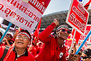 20 NOVEMBER 2013 - BANGKOK, THAILAND:  A Red Shirt supporter rallies in support of the government. Thousands of Red Shirts, supporters of the Pheu Thai ruling party in Thailand, gathered in Rajamangala Stadium in suburban Bangkok to listen to the Thai Constitutional Court deliver its verdict against the government. The court ruled that the recent efforts by the government to pass a blanket amnesty bill violated the Thai Constitution but the court did not order the party to disband or the dissolution of the government, which had been widely feared.    PHOTO BY JACK KURTZ