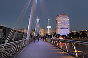 Golden Jubilee Bridge at dusk, London, UK. Named in honor of the Queen's fiftieth anniversary as monarch, the cable-stayed pedestrian bridge of the Hungerford Bridge was inaugurated in 2002, designed by Lifschutz Davidson Sandilands (architects) and WSP Group plc (engineering). Picture by Manuel Cohen.The use of this image may require further clearance / Merci de vous assurer que l'utilisation finale de l'image ne necessite pas d'autorisation supplementaire.