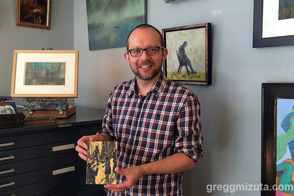 Samuel Paden, a encaustic, mixed media artist, holds Crossroad (7&quot; x 5&quot; encaustic on panel) in his Garden City, Idaho studio on October 10, 2015.<br />