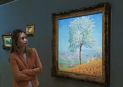 Bonhams, London, February 27th 2017. A member of Bonhams staff admires Francis Picabia's 'Les argues en fleurs Villeneuve-sur-Yonne', which is expected to sell for between £130,000 and £180,000, at the Bonhams impressionist and modern art sale press preview at their Mayfair gallery in London.