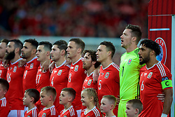 CARDIFF, WALES - Monday, October 9, 2017: Wales players stand for the national anthem before the 2018 FIFA World Cup Qualifying Group D match between Wales and Republic of Ireland at the Cardiff City Stadium. Hal Robson-Kanu, Tom Lawrence, Ben Davies, Andy King, Joe Allen, James Chester, goalkeeper Wayne Hennessey and captain Ashley Williams. (Pic by Paul Greenwood/Propaganda)